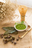 Set of matcha powder bowl, wooden spoon and whisk, green tea lea. F, Organic Green Matcha Tea ceremony Stock Photo