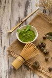 Set of matcha powder bowl, wooden spoon and whisk, green tea lea. F, Organic Green Matcha Tea ceremony Royalty Free Stock Photos