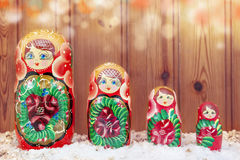 Set of matryoshka covered by christmas snow warm look filtered Stock Image