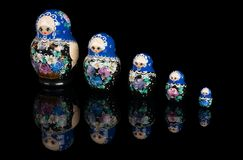 Set of matryoshka dolls on black Stock Photography