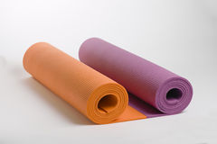 A set of mats for yoga and pilates. Colored mats for doing yoga or pilates Royalty Free Stock Photo