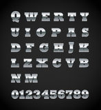 Set of matte metal letters. On black Stock Image