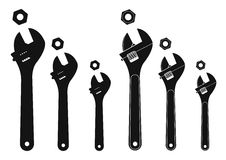 Set of mechanical wrenches with nuts. Silhouettes Royalty Free Stock Photography
