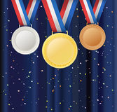 Set of medals and ribbons over curtain background with confetti Royalty Free Stock Image