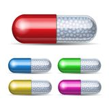 Set of medical capsule with granules. On white background. Vector illustration Stock Images