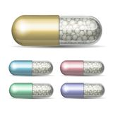 Set of medical capsule with granules Stock Image