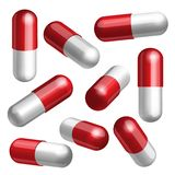 Set of medical capsules in different positions Royalty Free Stock Photo