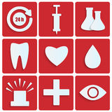 Set of medical icons. Icons of the white paper.set of medical icons on red background.Icons for the hospital Royalty Free Stock Images
