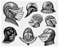 Set of medieval symbols Battle Helmets for knights or kings, vintage, engraved hand drawn in sketch or wood cut style Stock Photography