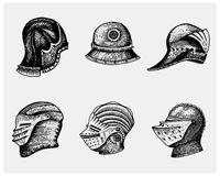 Set of medieval symbols Battle Helmets for knights or kings, vintage, engraved hand drawn in sketch or wood cut style Royalty Free Stock Photo
