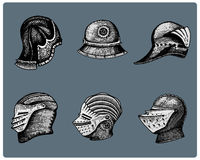 Set of medieval symbols Battle Helmets for knights or kings, vintage, engraved hand drawn in sketch or wood cut style Royalty Free Stock Image