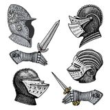 Set of medieval symbols Battle Helmets for knights or kings, vintage, engraved hand drawn in sketch or wood cut style Stock Images