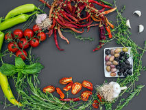 Set of mediterranean vegetables on a dark background with a pace. Set of mediterranean vegetables, greens and spices on a dark background with a pace for Stock Photo