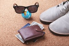 Set of men`s accessories for the tourist on a white wooden background. The concept of fashion, leisure and travel. Set of men`s accessories for the tourist on a Royalty Free Stock Photos