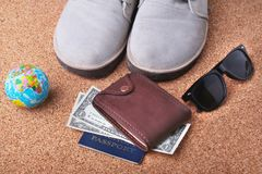 Set of men`s accessories for the tourist on a white wooden background. The concept of fashion, leisure and travel. Set of men`s accessories for the tourist on a Royalty Free Stock Photography