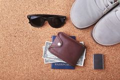 Set of men`s accessories for the tourist on a white wooden background. The concept of fashion, leisure and travel. Set of men`s accessories for the tourist on a Stock Photos