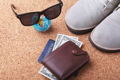 Set of men`s accessories for the tourist on a white wooden background. The concept of fashion, leisure and travel. Set of men`s accessories for the tourist on a Stock Images
