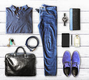 Set of men's clothing and accessories. On a white wooden background Royalty Free Stock Image