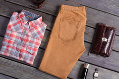 Set of men's clothing. Clothing and accessories on a wooden background Royalty Free Stock Images