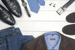 Set of men's clothing and shoes on wooden background. Men accessories. Top view Stock Image