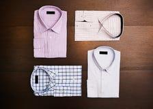 A set of 4 men`s shirts Stock Photos