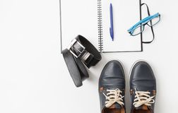 Set of men`s shoes and accessories on white Stock Image