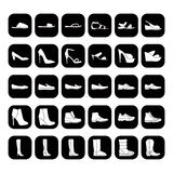 Set of men's and women's shoes icons, white black Royalty Free Stock Images