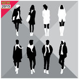 Set of men and women black silhouettes collection,editable. Eight black silhouettes of men and women with white cloths on,removable,editable Royalty Free Stock Image
