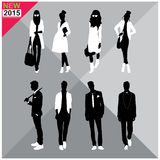 Set of men and women black silhouettes,. Eight silhouettes of both sexes Royalty Free Stock Images
