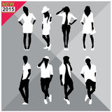 Set of men and women black silhouettes,. Eight silhouettes of both sexes Royalty Free Stock Image