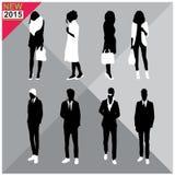 Set of men and women black silhouettes,. Eight silhouettes of both sexes Royalty Free Stock Photos