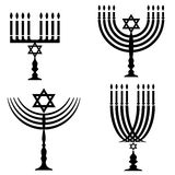 Set of Menorah Silhouettes Stock Photography