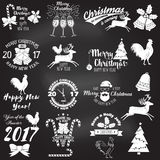 Set of Merry Christmas and Happy New Year 2017 typography design. Vector illustration on the chalkboard. Xmas retro badge. Concept for shirt or logo, print Royalty Free Stock Image