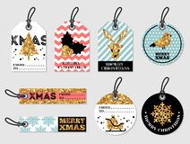 Set of Merry Christmas and New Year Gift Tags. Set of Merry Christmas and Happy New Year Gift Tags. Retro Style with Glittering Golden Pattern. Vector royalty free illustration