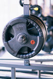 Set of metal barbells disks on barbell holder in the fitness gym Stock Image