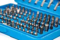 Set of metal bits in a blue plastic box Royalty Free Stock Images