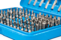 Set of metal bits in a blue plastic box Royalty Free Stock Image