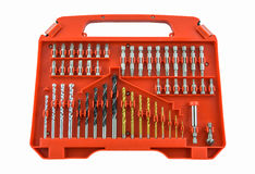 Set of metal drill bits in orange box. Isolated on white background Royalty Free Stock Photography