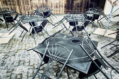 Set of metal garden chairs and tables in restaurant, it is close Stock Photo