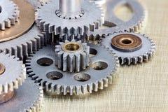 Set of metal gear cogwheels for industrial machinery macro Royalty Free Stock Photos
