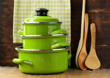 Set of metal green pots cookware Stock Photo