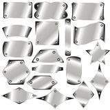 A set of metal plates. For your design Royalty Free Stock Photo