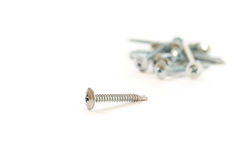 Set of metal screws on the white background Royalty Free Stock Images