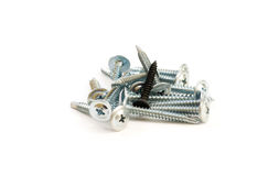 Set of metal screws on the white background. One black the other Royalty Free Stock Photos