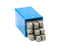 Set of metal stamp number punch in blue plastic box Royalty Free Stock Image