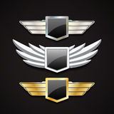 Set of Metal and Stone Wings with Glossy Shields Royalty Free Stock Images