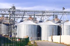Set of metal tanks aligned under structures and gangway stock photo
