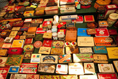 Set of metal tins from Cuban cigars and cigarettes on showcase of flea-market Royalty Free Stock Photo