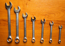 Set of metal wrenches. On a wooden background Royalty Free Stock Photos