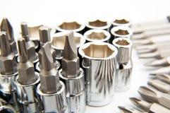 Set of metallic tools as background. Set of metallic shiny tools on white background Royalty Free Stock Images